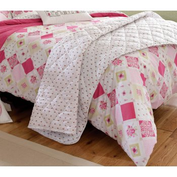 Kirsty allsopp lottie raspberry quilted vintage vintage bedspread and a cushion